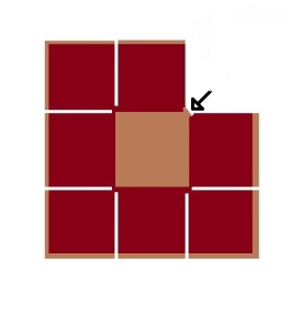 Fold the top right square diagonally down and to the left, and place it on top of the central square.