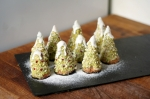 Cone-shaped Christmas Tree Cakes on a slate